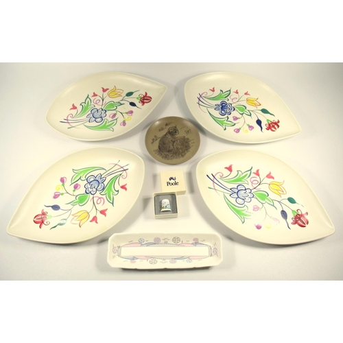 148 - A QUANTITY OF POOLE POTTERY COMPRISING FOUR PATTERN No. 91 LEAF SHAPED DISHES SIGNED BN, A BONE CHIN...