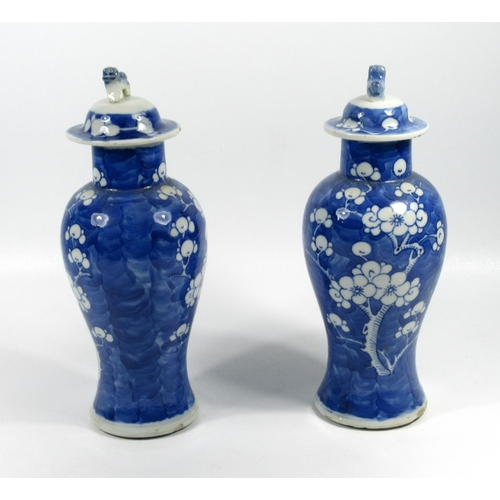 152 - A PAIR OF EARLY 20TH CENTURY CHINESE BLUE & WHITE BALUSTER VASES EACH WITH A COVER, (H. 21.5 CM) (4)...
