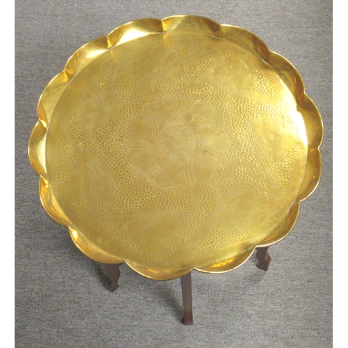 176 - ARTS & CRAFTS BRASS SHAPED CIRCULAR TRAY WITH HAMMERED AND ENGRAVED STYLISED FLORAL DECORATION WITHI...