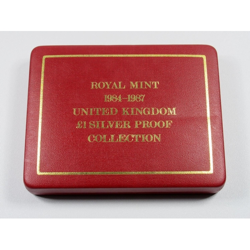 22 - SILVER PROOF SET OF ELIZABETH II £1 COINS, 1984-87, WITH PLAQUE, (4) WITH C OF A, CASED....