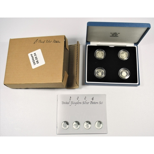 26 - SILVER PROOF SET OF ELIZABETH II PATTERN £1 COINS, 2004,(4) WITH C OF A, IN A DELUXE CASE, BOXED....