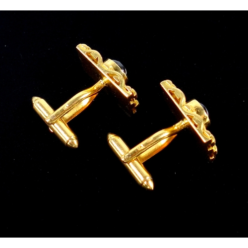30 - PAIR OF YELLOW METAL WEAVE EFFECT CUFF LINKS, EACH SET WITH A STAR SAPPHIRE, TESTED AS 18 CT, GROSS ...