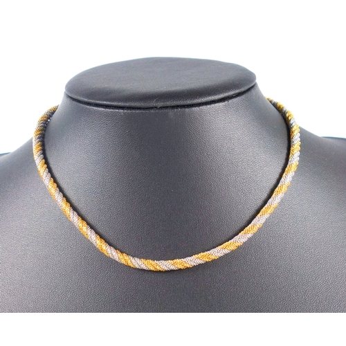 37 - ITALIAN YELLOW AND WHITE METAL TWO TONE CHAIN TWIST NECKLACE, STAMPED 750 (L. 40 CM), 34.5 GRAMS...