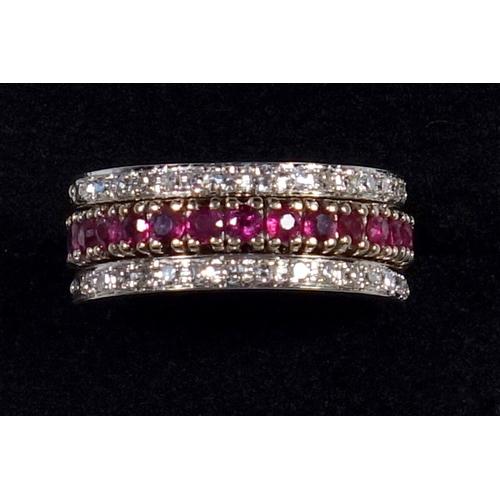 41 - YELLOW METAL TRIPLE ETERNITY RING (SIZE N) SET THIRTY DIAMONDS, FOURTEEN RUBIES AND FOURTEEN SAPPHIR...
