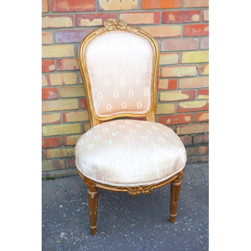156 - LOUIS XVI GILT CHAIR WITH A SHAPED BACK WITH RIBBON CRESTING AND UPHOLSTERED SEAT, ON FLUTED TURNED ...