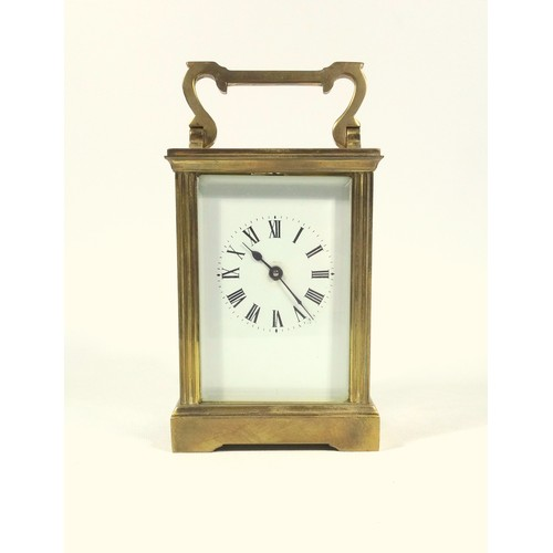 37 - FRENCH CARRIAGE TIMEPIECE WITH A WHITE ENAMELLED DIAL ENCLOSING AN EIGHT DAY MOVEMENT IN A BRASS CAS...
