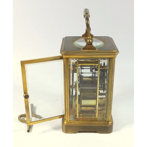 34 - EARLY 20TH CENTURY FRENCH CARRIAGE CLOCK WITH A WHITE ENAMEL DIAL ENCLOSING AN EIGHT DAY MOVEMENT, S...