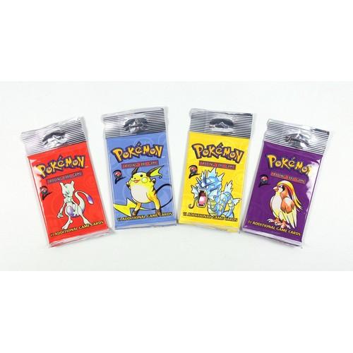 8 - Pokémon TCG Base Set 2 Booster Packs– Pidgeot, Raichu, Gyarados and Mewtwo, sealed in original packa...
