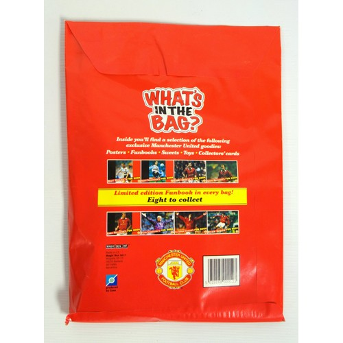 31 - Four rare unopened Manchester United Football Club 'WHAT'S IN THE BAG?' Toys, surprises and official...