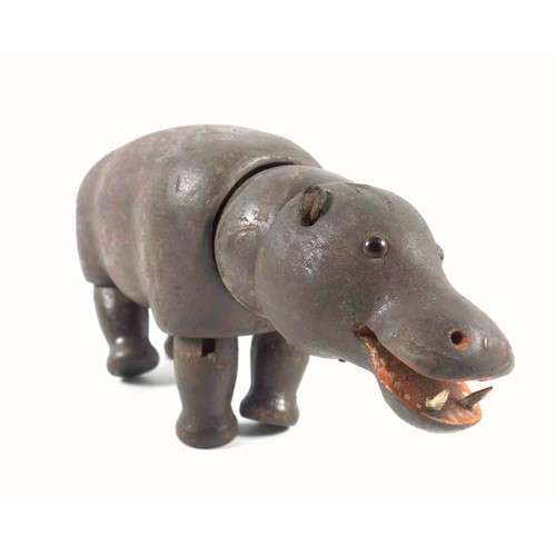 38 - A box of vintage painted wooden toys to include a three articulated African animals (Hippo, Lion and...