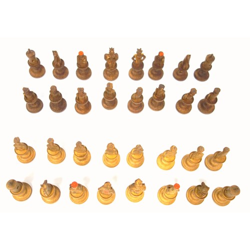 39 - Swiss light and dark carved wood chess set, mostly in the form of figures, of 32 pieces, height of k...