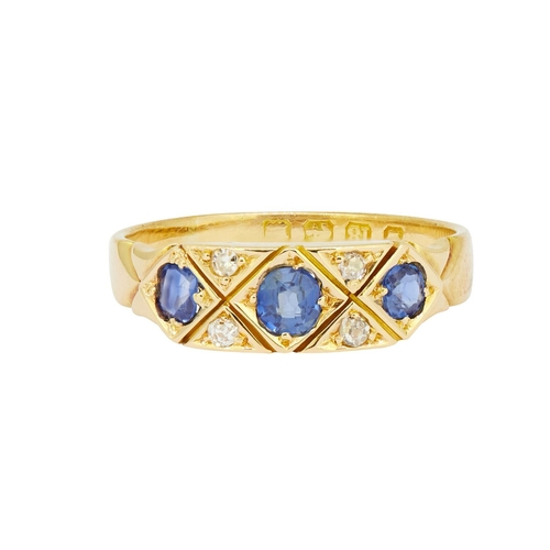 15 - SAPPHIRE AND DIAMOND RING SAPPHIRE AND DIAMOND RING, set with 3 blue sapphires, flanked with 4 diamo...