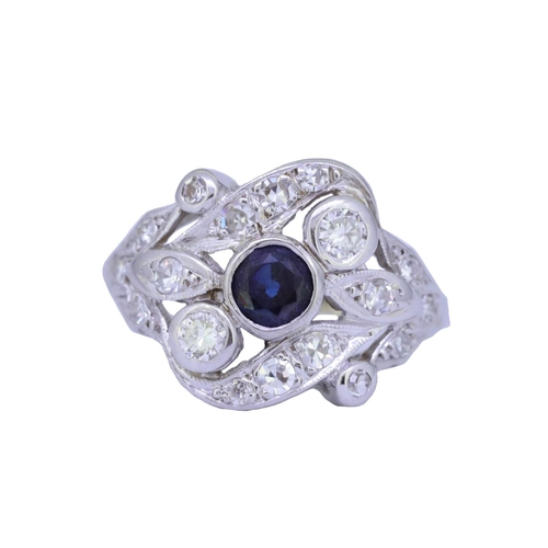 16 - SAPPHIRE DIAMOND RING SAPPHIRE AND DIAMOND DRESS RING, set to the center with a blue sapphire of app...