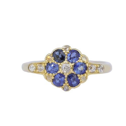 17 - SAPPHIRE AND DIAMOND RING SAPPHIRE AND DIAMOND RING, set with a central diamond, surrounded with blu...