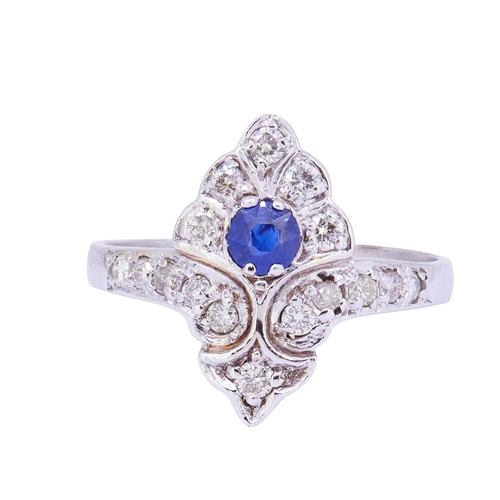 28 - SAPPHIRE AND DIAMOND DRESS RING SAPPHIRE AND DIAMOND DRESS RING, set with a blue sapphire of approx....