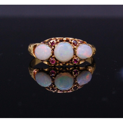 30 - ANTIQUE OPAL AND RUBY RING ANTIQUE OPAL AND RUBY RING, set with 3 opals, flanked by 4 diamonds. Size...