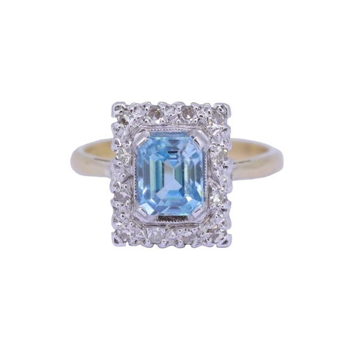 32 - ZIRCON AND DIAMOND CLUSTER RING ZIRCON AND DIAMOND CLSUTER RING, set with a central rectangular blue...