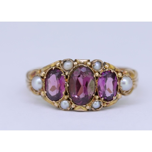 39 - ANTIQUE AMETHYST AND PEARL RING ANTIQUE AMETHYST AND PEARL RING, set to the center with 3 amethyst, ...