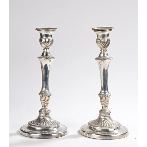 54 - Pair of plated candlesticks Pair of plated candlesticks, with swirled gadrooned sconces, gadrooned t...