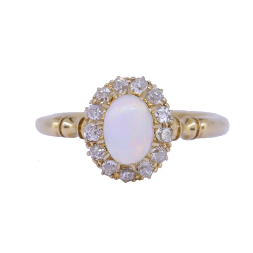 55 - OPAL AND DIAMOND CLUSTER RING OPAL AND DIAMOND CLUSTER RING, set with a central oval cabochon cut op...