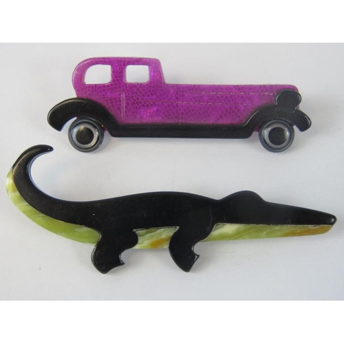 106 - Two Lea Stein brooches, a black and green crocodile and a pink and black Rolls Royce. Both with pins...