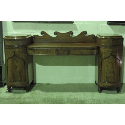 1100 - A late Georgian sideboard comprising central section with twin frieze drawers with shaped back, susp...