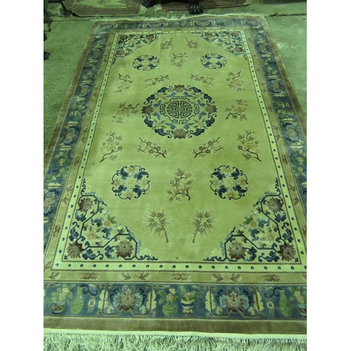 1106 - An early 20th C Oriental woollen and the silk cream ground rug having central oriental character, fo...