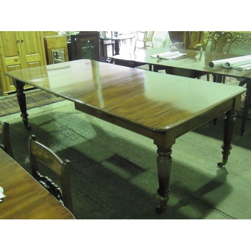 1111 - A fine quality 19th century large pull out dinning table with two additional leaves, reeded legs ter...