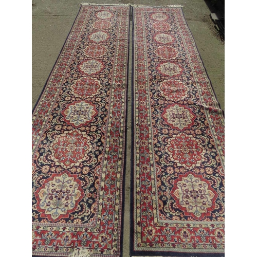 1117 - A fine pair of antique blue ground woollen runners having geometric design upon and each measuring 3...