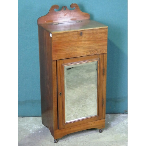 1120 - A late Victorian mahogany bedside pot stand having mirrored door and lidded compartment over 47cm wi...