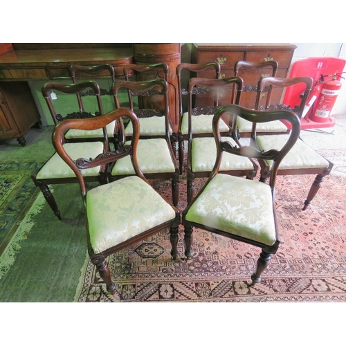 1122 - A set of ten (eight and two) rosewood dinning chairs, carved splat backs, drop in seats all in fine ...