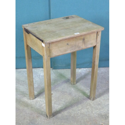 1127 - A vintage lidded child's school desk, 56cm wide....