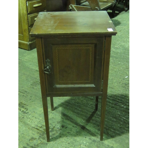 1129 - An Edwardian pot cupboard raised over square tapering legs...