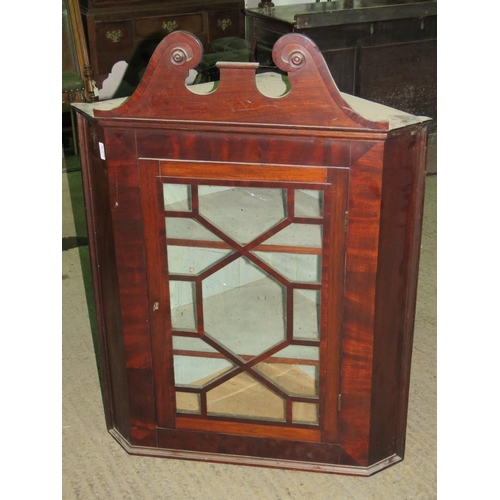 1130 - A Georgian style glazed door hanging corner cabinet....