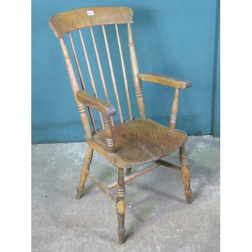 1135 - A elm seated spindle back chair raised over turned legs....