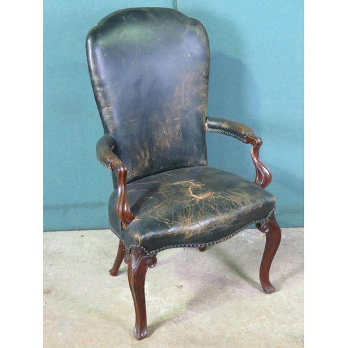 1137 - A 19th century Portuguese desk chair, oversprung seat and raised over shaped legs, covered in green ...