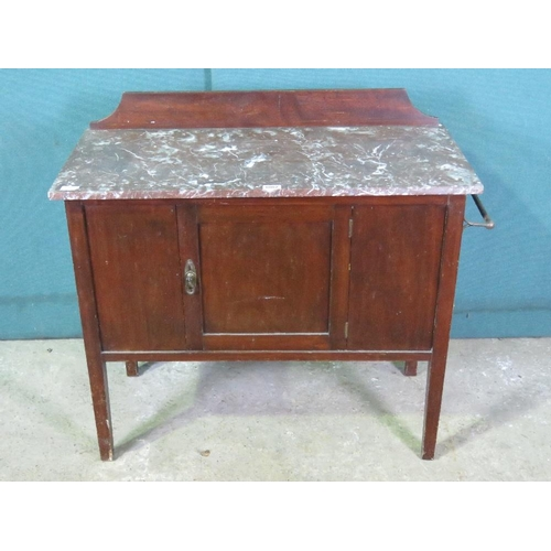 1140 - A rouge marble top Edwardian wash stand, single central door complete with towel rail, 92cm wide....