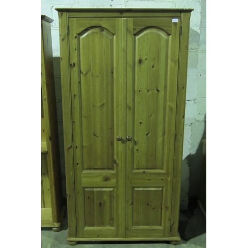 1141 - An contemporary two door pine wardrobe measuring 96 x 186 cm...