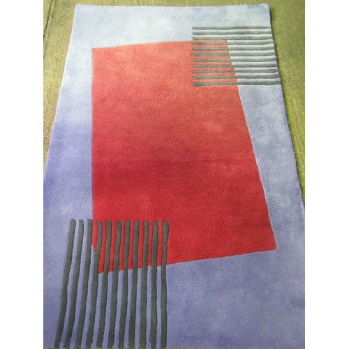 1142 - A contemporary playground rug having read offset central panel and measuring 185 x 120cm. AF....