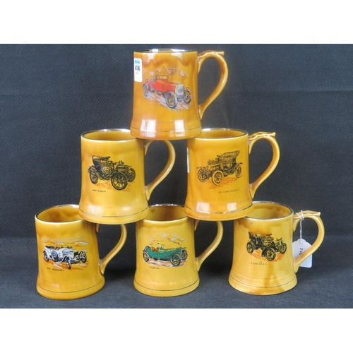 451 - A quantity of six Wade transfer-printed car-themed mugs with silver-gilded rims....