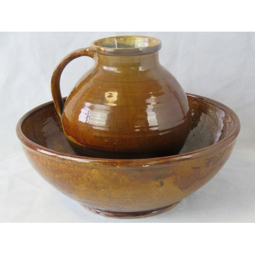 457 - Michael Cardew CBE.  English Studio Potter. 1991-1983. Brown glazed jug and bowl. Stamped under. Bow...