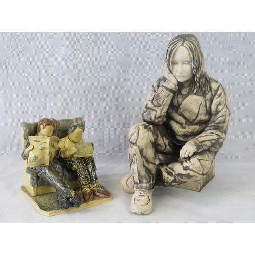 459 - Two contemporary pottery figurines. 'Seated gentlemen on a train seat' 13cm high by Huw Phillips (20...