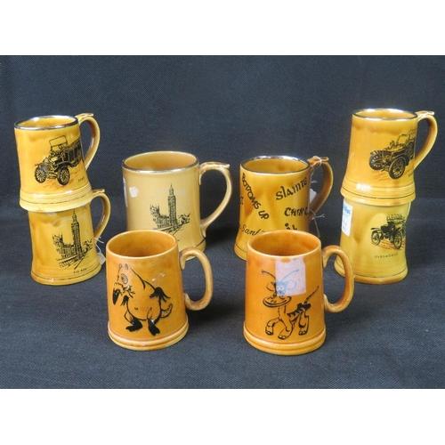 463 - A quantity of eight assorted Wade transfer-printed mugs. Various themes....
