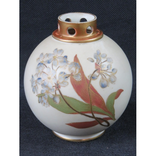 464 - A Royal Worcester pot pourri, blush ground with hand painted and gilded floral decoration. Puce back...