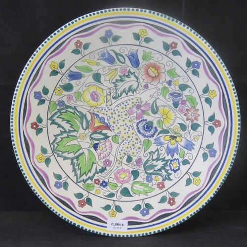 469 - A large Poole pottery charger hand painted by Susan Russell. 41cm diameter....