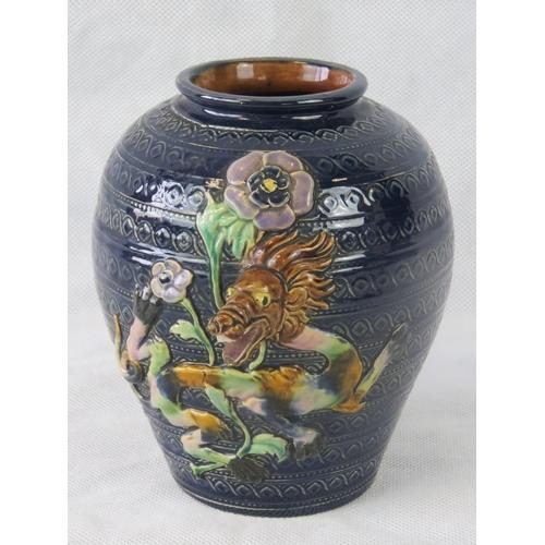 474 - An Austrian Art Nouveau vase with applied lion mask decoration. 16cm high....