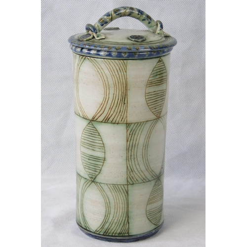 481 - Roelof Uys. Senior Production Potter. Leach Pottery, St Ives. A tall cylinder lidded pot with abstra...