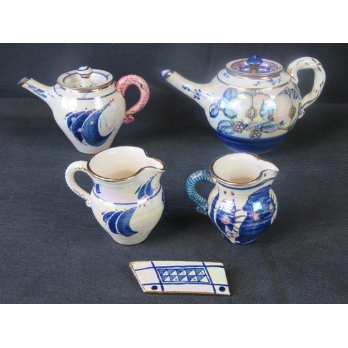 486 - An Alvin Irving four-piece tea set with associated 'badge.'...