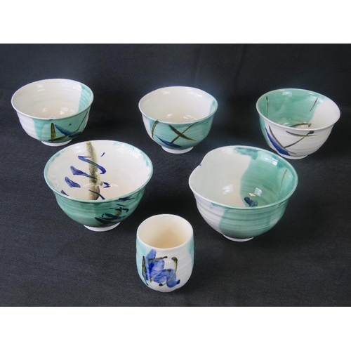 491 - Five Kirsty Adams Japanese style contemporary studio bowls with matching cup....