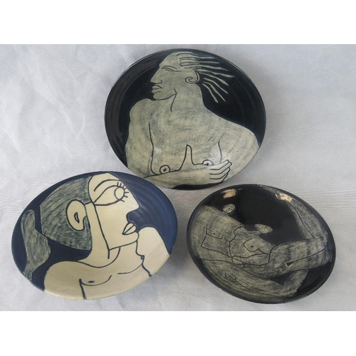 495 - Three items of abstract Wallace pottery each being a charger- two glazed and one unglazed....